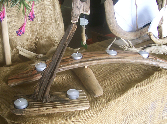 two driftwood votive candle holders at a craft market