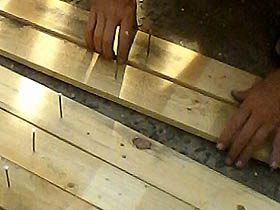 putting nails into pallet wood planks