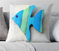 Green and blue striped wood angel fish cushion