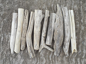 mostly quite straight driftwood pieces